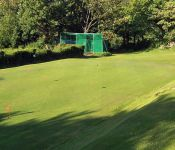 Putting green with practice nets